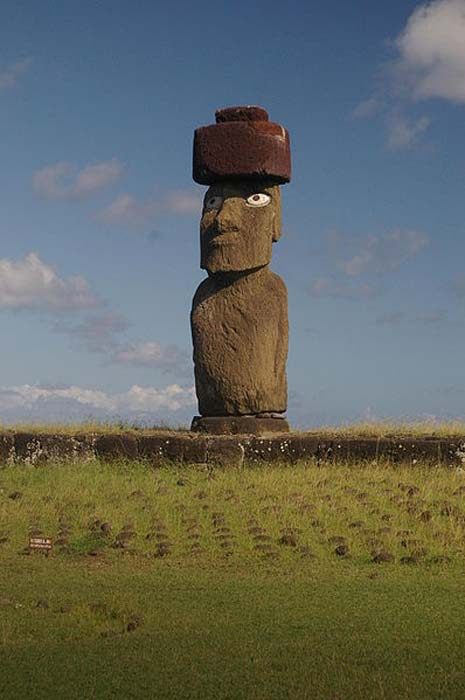"Moai Ko te Riku near Tahai, with pukao and ""restored"" with eyes, although they are only painted and not made of the original materials. (CC BY-SA 3.0)"