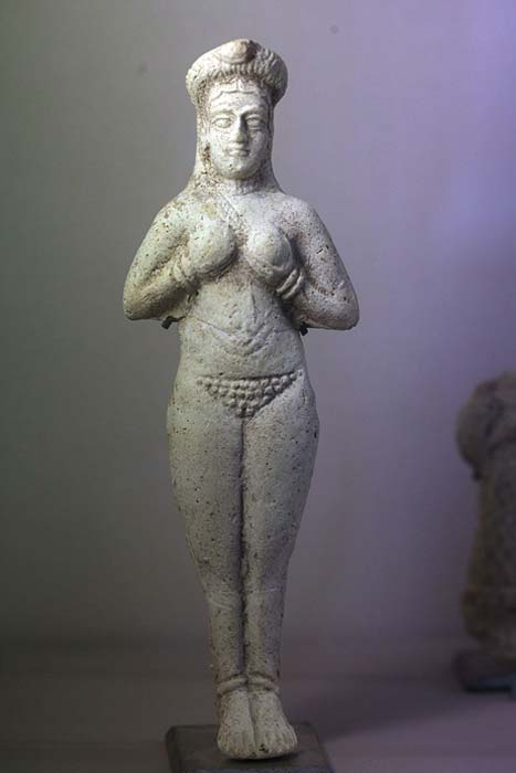 Molded naked figure holding breasts. Between 1300 and 1100 BC.
