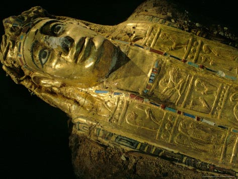 Mummy with gilded mask and cartonnage chest plate