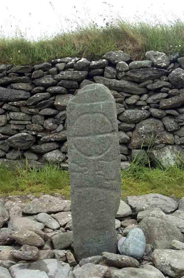 Ogham writing on an old Celtic cross, Gallarus, Ireland. (nyiragongo /Adobe Stock)