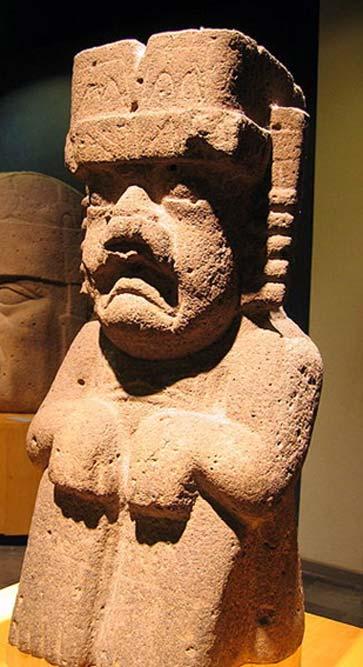 A seated Olmec were-jaguar statue.