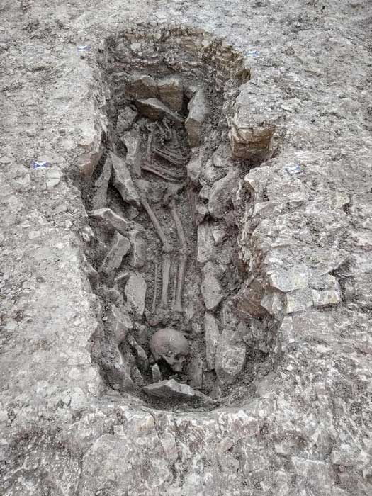 One person was found with their skull placed by their feet in the ancient death pit found in Oxfordshire. (Thames Water)