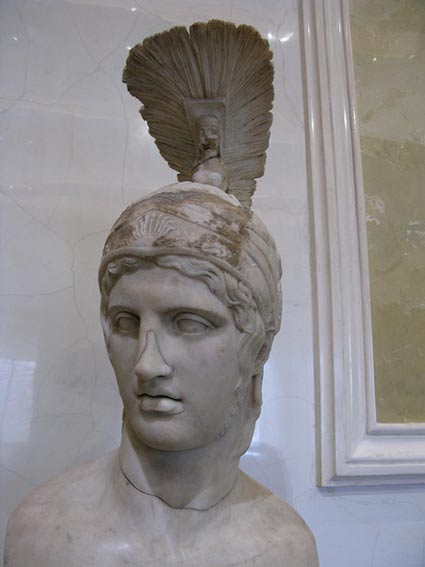 Ornamented helmets are not unknown, like this one on a Roman marble statue of the god of war (Aries/Mars). 2nd Century AD.