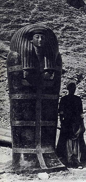 Outer coffin of Yuya's mummy. Excavation assistant beside 2.75-meter (9 feet) outer coffin, shortly after excavation, circa 1905. (Public Domain)