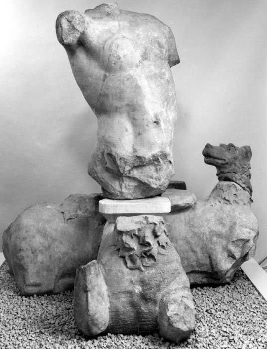Part of a marble statue of the sea monster Skylla: headless torso with right arm outstretched, left arm by side, both arms missing from just below the shoulder. (CC BY NC SA 4.0) This sculpture was found at a seaside tomb in Bargylia.