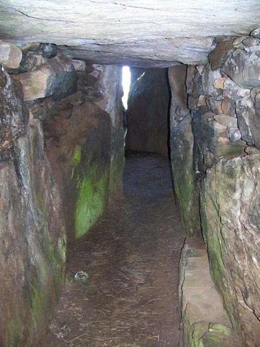 Passageway into Bryn Celli Ddu. The passage opens out to a bigger central chamber.