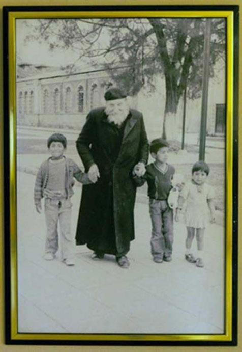 Photograph of Father Crespi with some local children.  Crespi Museum in the  Universidad Politécnica Salesiana. Credit: Ancient-Origins.net
