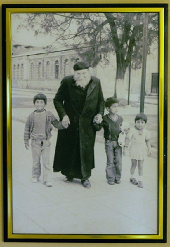 Photograph of Father Crespi with some local children. Crespi Museum in the Universidad Politécnica Salesiana.