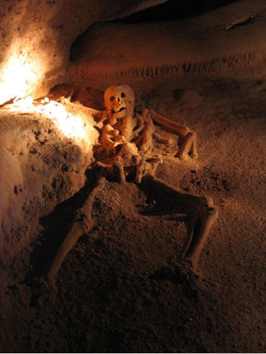 """Photograph of Maya sacrifice taken from within the cave Actun Tunichil Muknal in Belize. This skeleton is popularly known as the """"Crystal Maiden""""."""