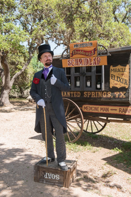 "Photograph of Ross Nelson, American Historical Interpreter, dressed as ""Professor Thaddeus Schmidlap"", a snake-oil salesman at the Enchanted Springs Ranch and Old West theme park, Boerne, Texas. (Public Domain)"