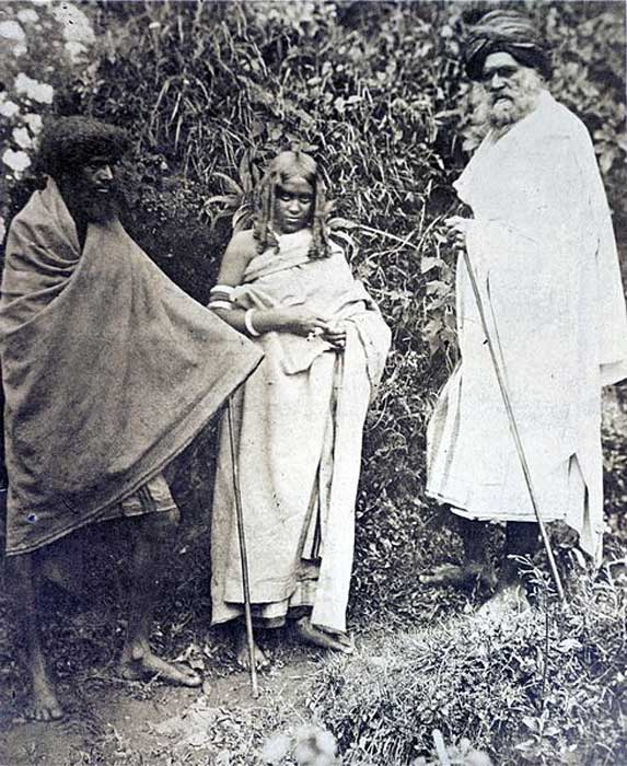 Photograph of two Toda men and a woman from the Nilgiri Hills in Tamil Nadu, taken by an unknown photographer from the Madras School of Arts in c. 1871-72.