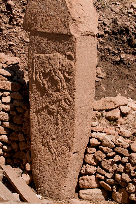 Pillar 2 from Enclosure A (Layer III) with low reliefs of what are believed to be a bull, fox, and crane. Gobekli Tepe, Urfa.