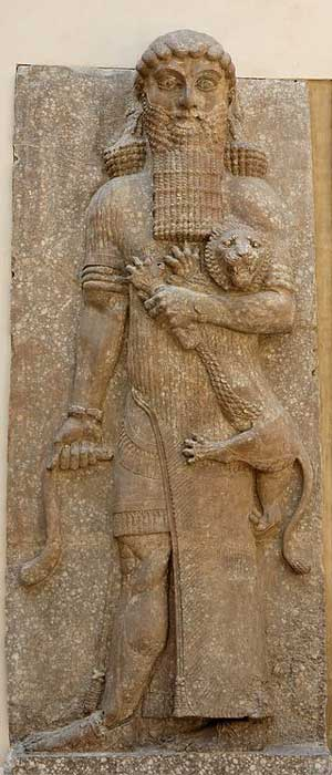 Possible representation of Enkidu as Master of Animals grasping a lion and snake, in an Assyrian palace relief, from Dur-Sharrukin, now Louvre (Public Domain)