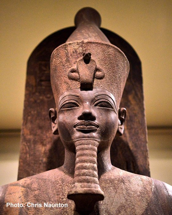 Probably a cult statue, this detail of a vibrant quartzite sculpture depicts an able-bodied, sled-borne image of a striding Amenhotep III wearing the Double Crown. It was found in the famed Luxor Cachette in 1989 on the western side of the king's colonnaded solar court. Luxor Museum.
