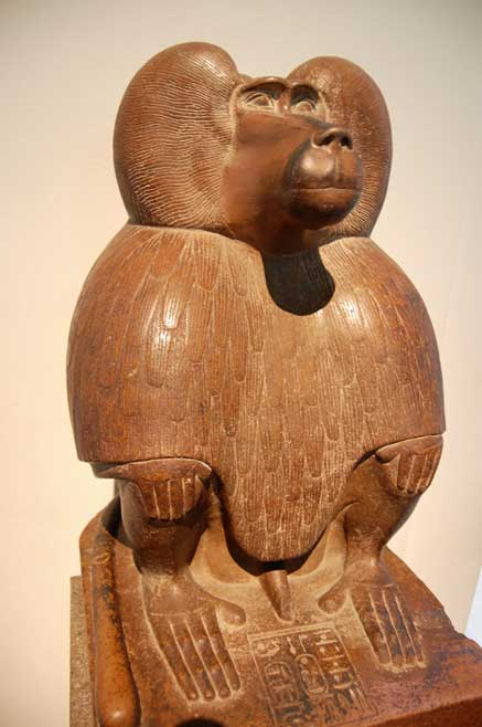 Quartzite sculpture of a seated                  hamadryas baboon (c. 1400 BC), depicting the god Thoth.                  British Museum. (Photo: CC by SA 3.0 / Steven G.                  Johnson)