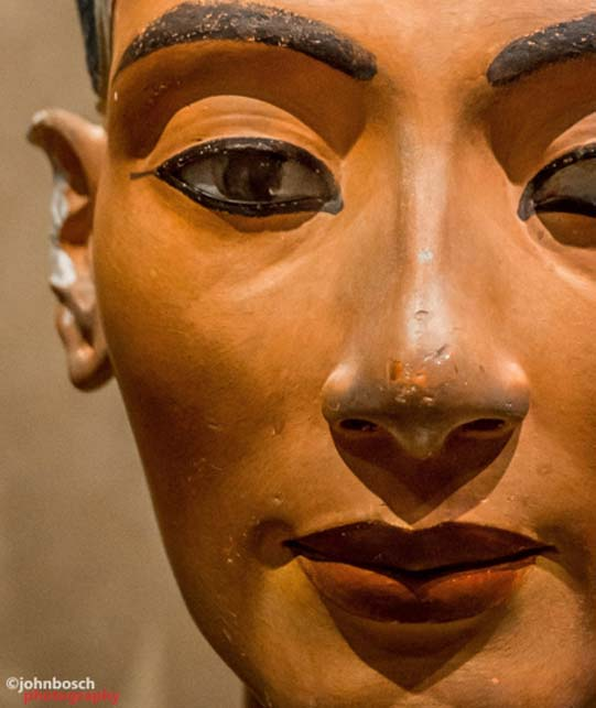 Detail of what is undoubtedly the world's most famous painted stucco-coated limestone bust. Queen Nefertiti, the 'Great Royal Wife' of Akhenaten was one of the most powerful women in her time. It is suggested that she co-ruled with her husband, and possibly, independently upon his death. Egyptian Museum, Berlin.