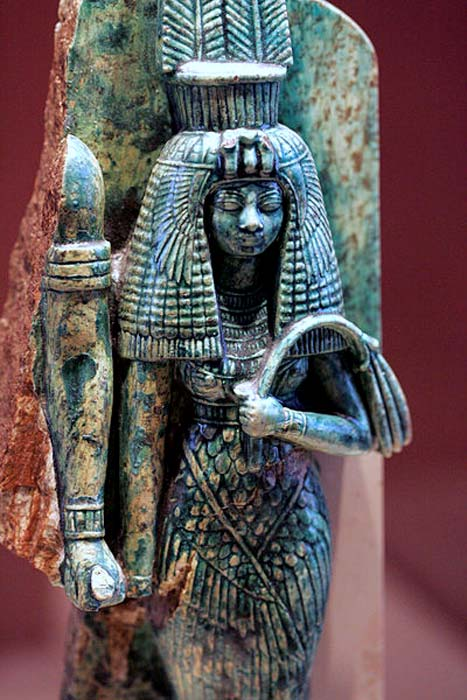 Queen Tiye. Her husband may have been depicted to her right in this broken statue.