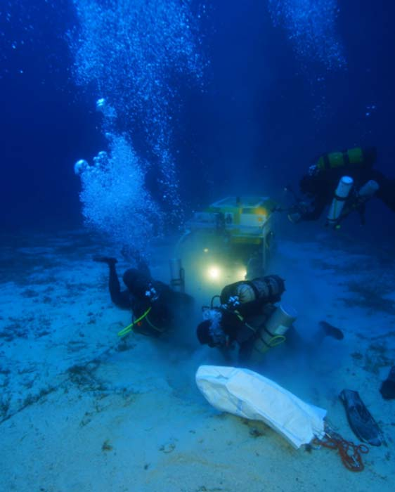 Archaeologists and the ROV robot work to recover an ancient North African amphora by Vasilis Mentogianis