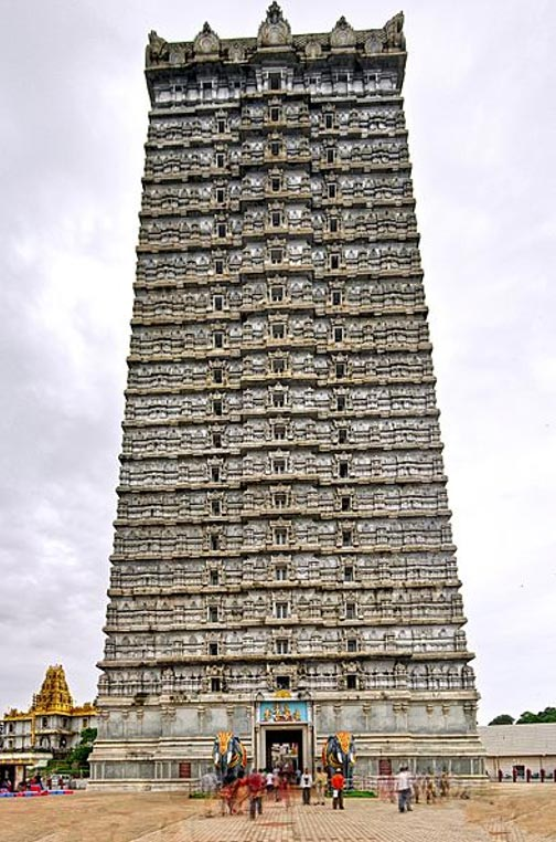 An HDR image of the 22-storied Raja Gopura at Murudeshwar temple. Two life-size elephants in concrete stand guard at the steps leading to it.