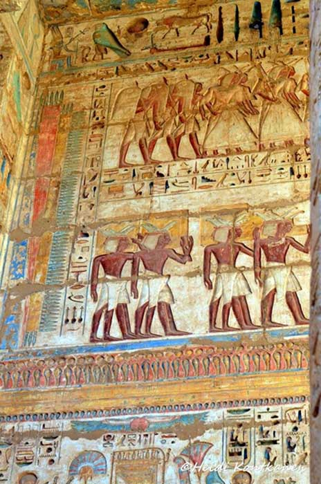 Ramesses III introduced the system of deeply carved inscriptions, probably in an effort to discourage successors from usurping his monuments. If so, the ploy worked very well. In this colorful scene, subjects from different lands await their turn to pay homage to the Pharaoh during the Festival of Min.