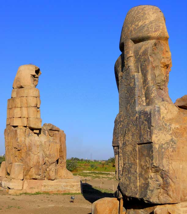 Rear view of the Colossi of Memnon: the towering 65-foot high quartzite sandstone statues that depict Amenhotep III at Kom el-Hetan, near Luxor.