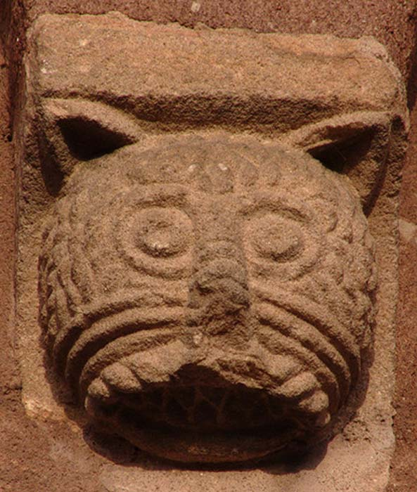 Romanesque relief head of cat at Sigolshein, France.