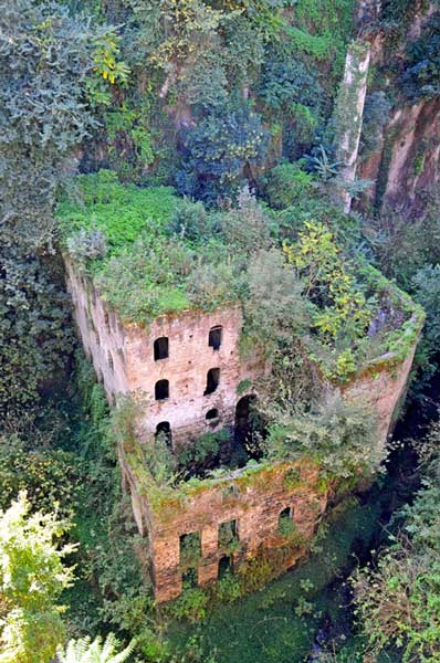 Ruins of a mill by water in the Valle dei Mulini.