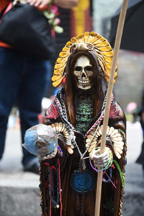 Santa Muerte, is commonly depicted as a female skeletal saint in bridal gowns or religious robes.
