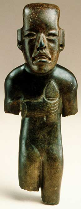 Sculpture of an Olmec child holding a torch.