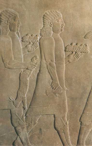 Servants back from a royal hunt bearing a hare and small birds. Relief from Ashurbanipal's palace at Nineveh, 7th century BC. (Yale University Library)