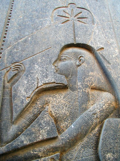 Seshat carved on the back of the throne of the seated statue of Rameses II in the Amun temple at Luxor.