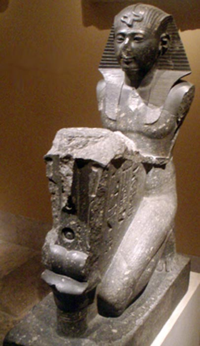 Seti I making an offering to Osiris.