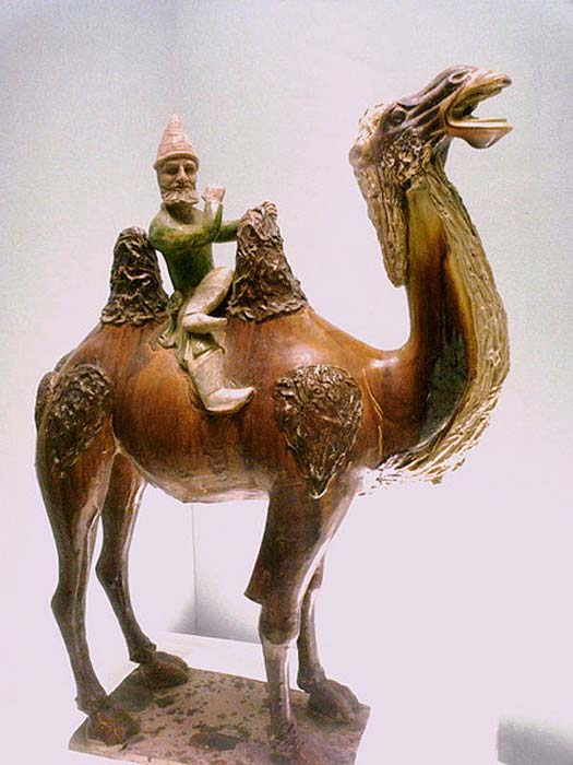 Sogdian on a camel, Chinese Tang Dynasty (618-907). Shanghai Museum. (Public Domain) Perhaps the holy man gave her a camel and a man to help her sneak past the guards?