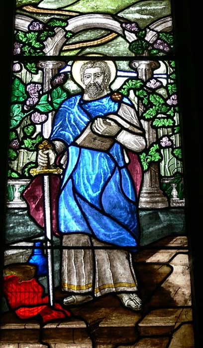 St.Collen parish church: Stained glass window showing Saint Collen.