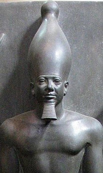Statue of Menkaure, Egyptian Museum, Cairo. The temples of Menkaure and Khentkawes I are close together leading many to believe that there was some kind of familial relationship between the two.