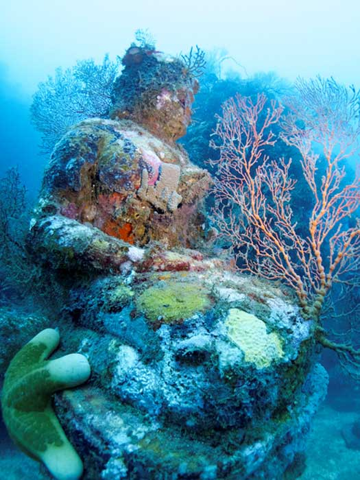 Statue of lord Buddha photographed during a dive at the Temple, near Pemuteran, Bali
