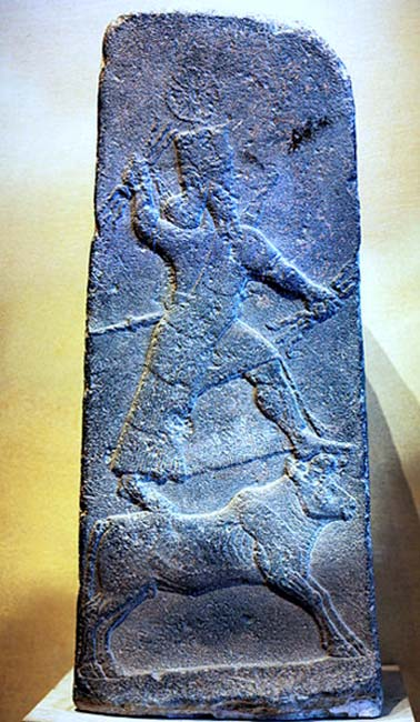 Stele of god Adad on a bull with a thunderbolt in hand