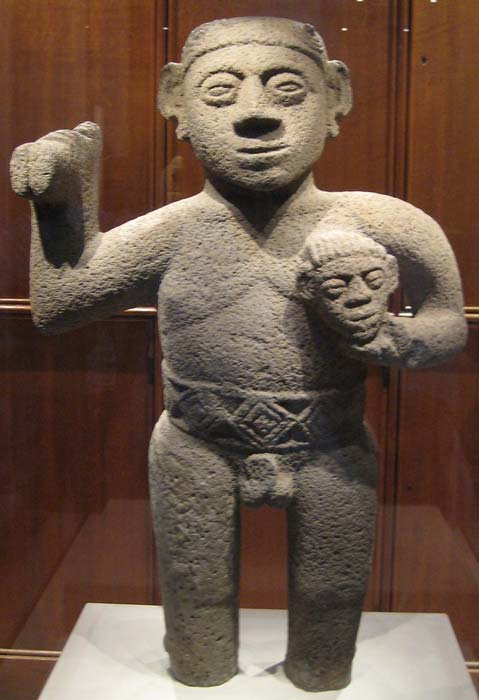 Stone figurine of a warrior holding a trophy head, from Costa Rica, AD 1000-1500. (CC0)​