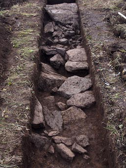 Stones placed inside a ditch to create the outline of the moose geoglyph