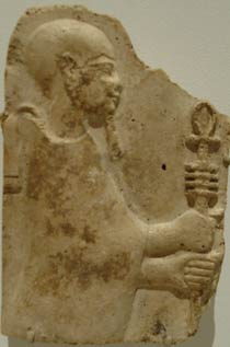 Stucco relief of Ptah holding a staff