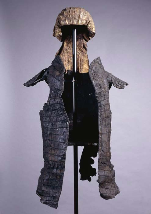 Suit of parade armor used by a Roman soldier during cult processions, consisting of a helmet and cuirass, both made of sewn crocodile skin. British Museum