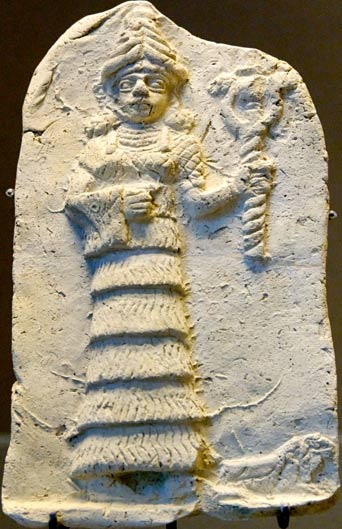 The Sumerian Nammu, depicted with her mountain hat representing the mountain from which she descended after the Flood, and holding the double-headed serpent symbolizing the serpent's rule in the pre-Flood world, and now in the post-Flood world as well.
