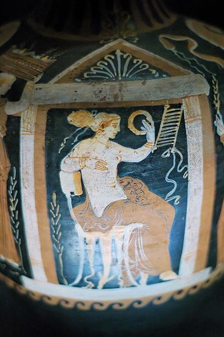 Detail of a sitting woman holding a crown. Terracotta, Apulian vase, late 4th century BC. Museum Santa Maria della Scala, Siena, Italy.