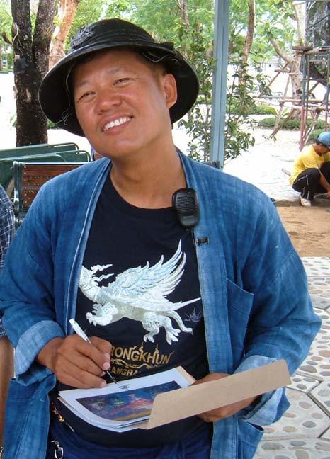 Thai artist Chalermchai Kositpipat at Wat Rong Khun in Chiang Rai, Thailand.