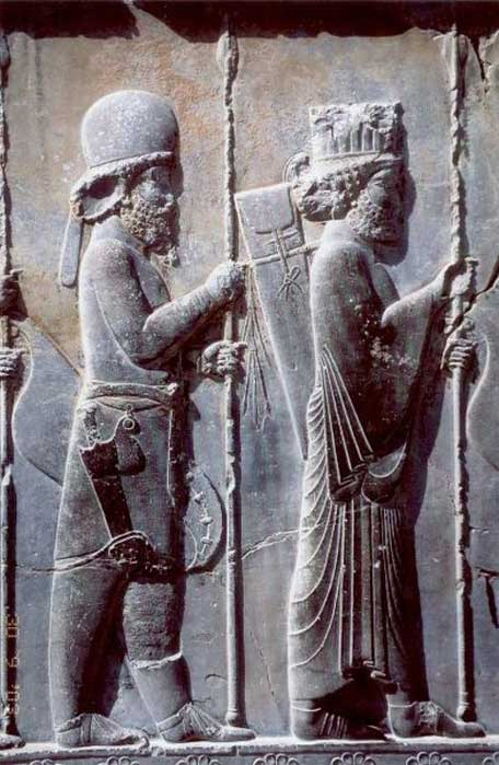 The Apadana Palace in Persepolis, Iran, northern stairway (detail) – fifth-century BC Achaemenid bas-relief shows a Mede soldier in traditional Mede costume (behind Persian soldier). (Public Domain)