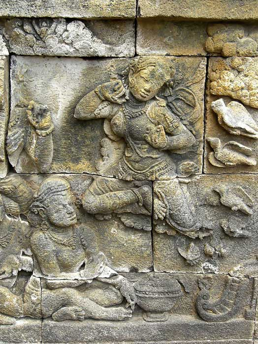 The Apsara of Borobudur, the flying celestial maiden depicted in a bas-relief of the 9th-century Borobudur temple, Java, Indonesia.