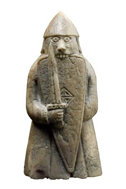 The Lewis Chessmen: A warder (rook) taking the form of a wild-eyed Berserker biting his shield with battle fury. (Photo: British Museum)