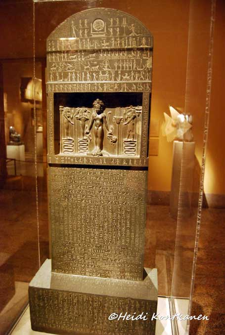 The central scene of the Metternich Stela (Horus-stele or 'cippus' stone slabs) shows the figure of the child Horus, or Harpocrates, associated with the newborn sun, with the head of the god Bes above him. He stands on two crocodiles and holds dangerous animals (snakes, scorpion, lion, and antelopes), demonstrating that with supernatural powers even a child can overcome dangers. The inscriptions are a set of 13 spells against poison and illness. These were designed to be said by a physician treating a patient, but their effectiveness could also be absorbed by drinking water that had been poured over the stele. Reign of Nectanebo II. Thirtieth Dynasty. Metropolitan Museum of Art, New York.