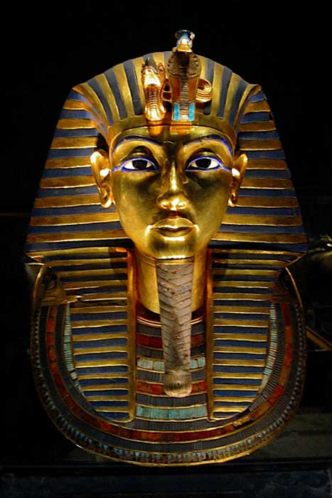 The death mask of Egyptian pharaoh Tutankhamun is made of gold inlaid with colored glass and semiprecious stone
