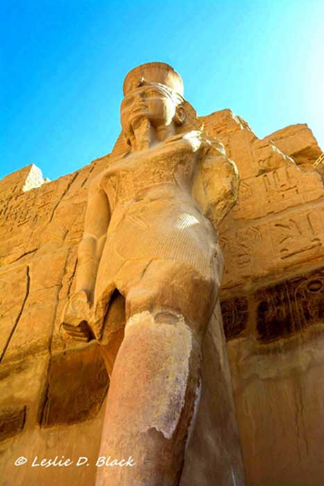 The eastern colossus of Ramesses III, standing at around 6 meters against the pylon entrance to the barque-shrine temple at Karnak; erected by the king to receive the barques of the Theban triad. The Pylon that featured traditional scenes of the king smiting his enemies only differed from Karnak's other similar entrances in its lack of flagstaffs.